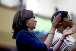 Democratic presidential candidate Kamala Harris stands next to her South Carolina state director Jalisa Washington-Price, right, during music worship on Sunday, Sept. 22, 2019, at Royal Missionary Baptist Church in North Charleston, S.C. (AP Photo/Meg Kinnard)