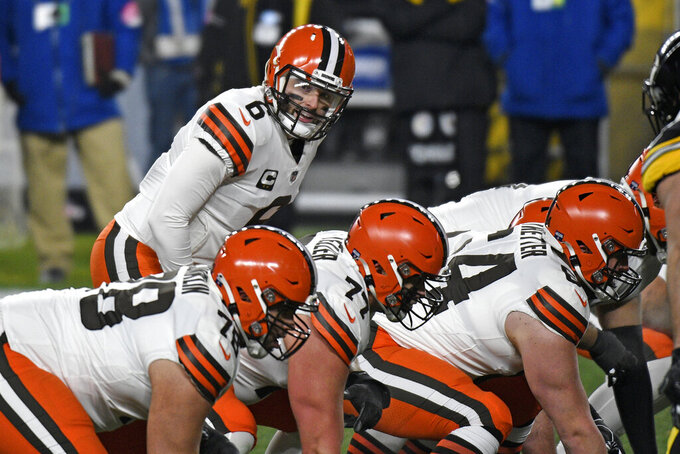 Cleveland Browns quarterback Baker Mayfield (6) lines up behind center during the first half of an NFL wild-card playoff football game against the Pittsburgh Steelers in Pittsburgh, Sunday, Jan. 10, 2021. (AP Photo/Don Wright)