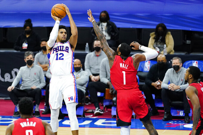 Philadelphia 76ers' Tobias Harris (12) goes up for a shot against Houston Rockets' John Wall (1) during the second half of an NBA basketball game, Wednesday, Feb. 17, 2021, in Philadelphia. (AP Photo/Matt Slocum)
