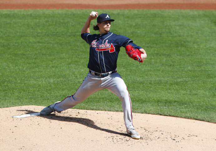 Atlanta Braves starting pitcher Kyle Wright throws against the New York Mets during the first inning of a baseball game, Sunday, Sept. 20, 2020, in New York. (AP Photo/Noah K. Murray)