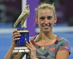 Belgium's Elise Mertens poses with her trophy after she defeated Romania's Simona Halep in a final match of the Qatar Open tennis tournament in Doha, Qatar, Saturday, Feb. 16, 2019. (AP Photo/Kamran Jebreili)
