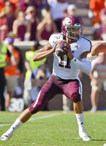Texas A&M quarterback Kellen Mond drops back to pass during the first half of an NCAA college football game against Clemson Saturday, Sept. 7, 2019, in Clemson, S.C. (AP Photo/Richard Shiro)
