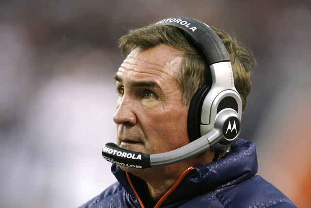 FILE - In this Nov. 25, 2007, file photo, Denver Broncos coach Mike Shanahan watches his team during the first quarter of an NFL football game against the Chicago Bears in Chicago. Shanahan has been elected to the Denver Broncos Ring of Fame and will be inducted in 2021 because of COVID-19 precautions. Shanahan was coach from 1995-2008 after serving as a Broncos assistant from 1984-87 and 1989-91. (AP Photo/M. Spencer Green, File)