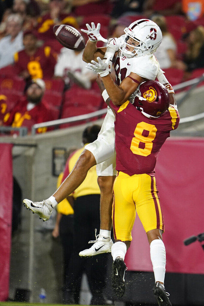 Stanford wide receiver Brycen Tremayne, top, makes a catch over Southern California cornerback Chris Steele (8) during the second half of an NCAA college football game Saturday, Sept. 11, 2021, in Los Angeles. (AP Photo/Marcio Jose Sanchez)
