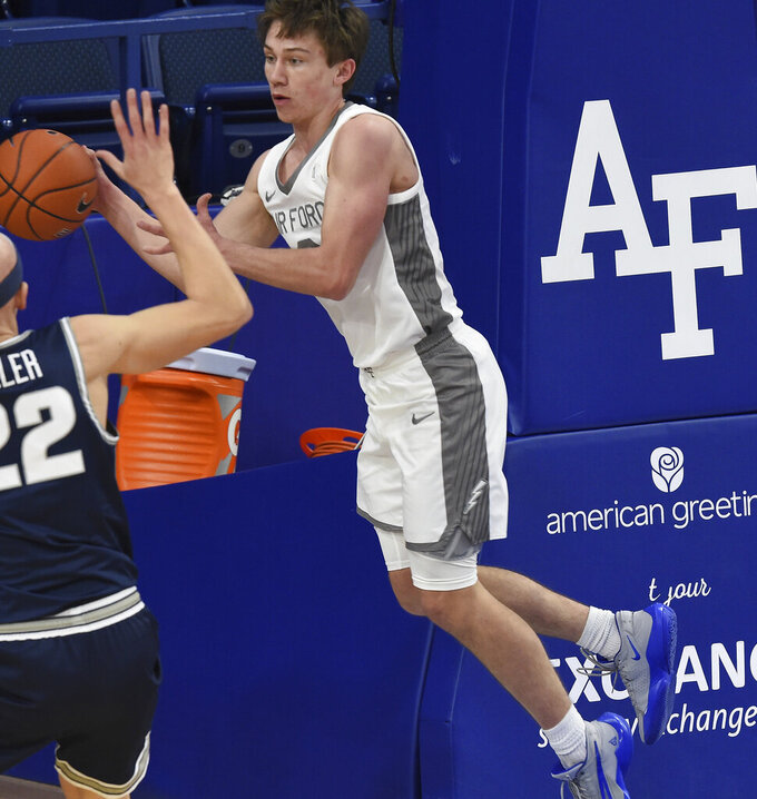 Air Force's Glen McClintock passes the ball during the second half against Utah State in an NCAA college basketball game Thursday, Dec. 31, 2020, at Air Force Academy, Colo. (Jerilee Bennett/The Gazette via AP)