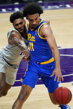 Pittsburgh guard/forward Justin Champagnie, right, drives against Northwestern guard Anthony Gaines during the first half of an NCAA college basketball game in Evanston, Ill., Wednesday, Dec. 9, 2020. (AP Photo/Nam Y. Huh)
