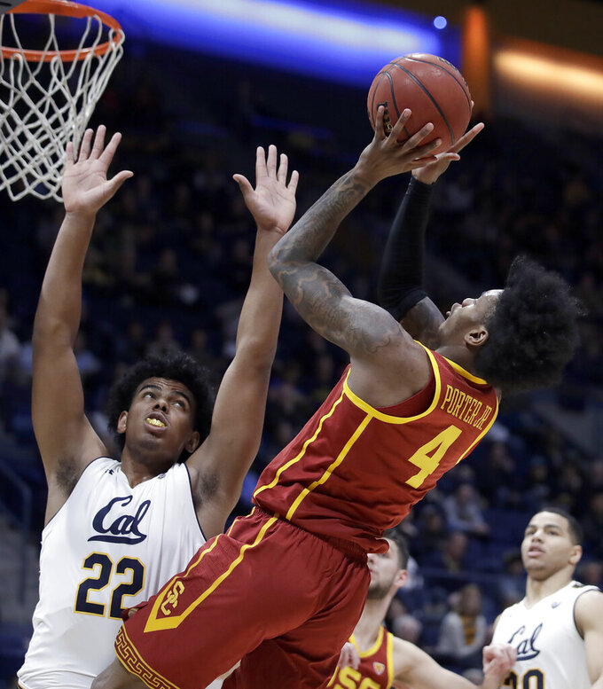 Southern California's Kevin Porter Jr., front right, shoots against California's Andre Kelly (22) in the second half of an NCAA college basketball game Saturday, Feb. 16, 2019, in Berkeley, Calif. (AP Photo/Ben Margot)