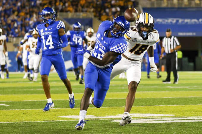 Kentucky defensive back Yusuf Corker (22) misses a dive for an interception during the second half of the team's NCAA college football game against Missouri in Lexington, Ky., Saturday, Sept. 11, 2021. (AP Photo/Michael Clubb)