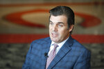 Phillip J. Castellini, president and chief operating officer, of the Cincinnati Reds baseball team speaks during an interview at Great American Ball Park, Monday, Jan. 7, 2019, in Cincinnati. The Reds will play games in 15 sets of throwback uniforms, including navy blue and a