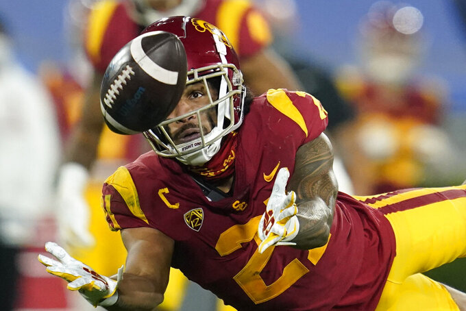Southern California safety Isaiah Pola-Mao (21) catches an interception during the second quarter of an NCAA college football game against UCLA, Saturday, Dec. 12, 2020, in Pasadena, Calif. (AP Photo/Ashley Landis)