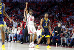Oklahoma's Jamal Bieniemy (24) watches as he makes a 3-pointer beside West Virginia's Brandon Knapper (2) during an NCAA college basketball game in Norman, Okla., Saturday, March 2, 2019. (Bryan Terry/The Oklahoman via AP)