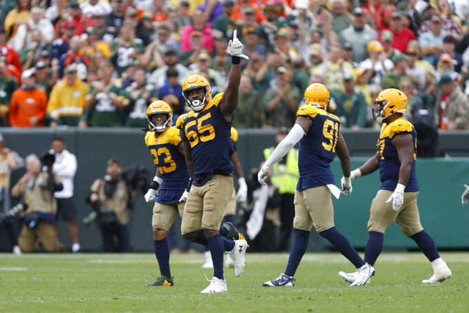Green Bay Packers outside linebacker Za'Darius Smith celebrates after sacking Denver Broncos quarterback Joe Flacco during the first half of an NFL football game Sunday, Sept. 22, 2019, in Green Bay, Wis. (AP Photo/Matt Ludtke)