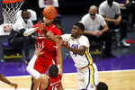 LSU forward Darius Days (4) reaches for a loose ball in front of Texas Tech guard Terrence Shannon Jr. (1) in the second half of an NCAA college basketball game in Baton Rouge, Saturday, Jan. 30, 2021. Texas Tech won 76-71. (AP Photo/Tyler Kaufman)