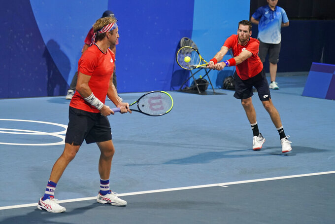 United States doubles team of Tennys Sandgren, left, and Austin Krajicek play a German team during the quarterfinals of the tennis competition at the 2020 Summer Olympics, Wednesday, July 28, 2021, in Tokyo, Japan. (AP Photo/Seth Wenig)