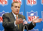 FILE - In this May 2, 2006, file photo, NFL Commissioner Paul Tagliabue responds to question at a news conference at the Dallas-Fort Worth International Airport in Grapevine, Texas. NFL team owners knew in 1989 they needed a leader who was going to bring the league out of the dark decade of the 1980s, when litigation, labor troubles and stagnant TV ratings dramatically slowed the growth of the league and hastened Pete Rozelle's departure. They chose Tagliabue. (AP Photo/Tony Gutierrez, File)