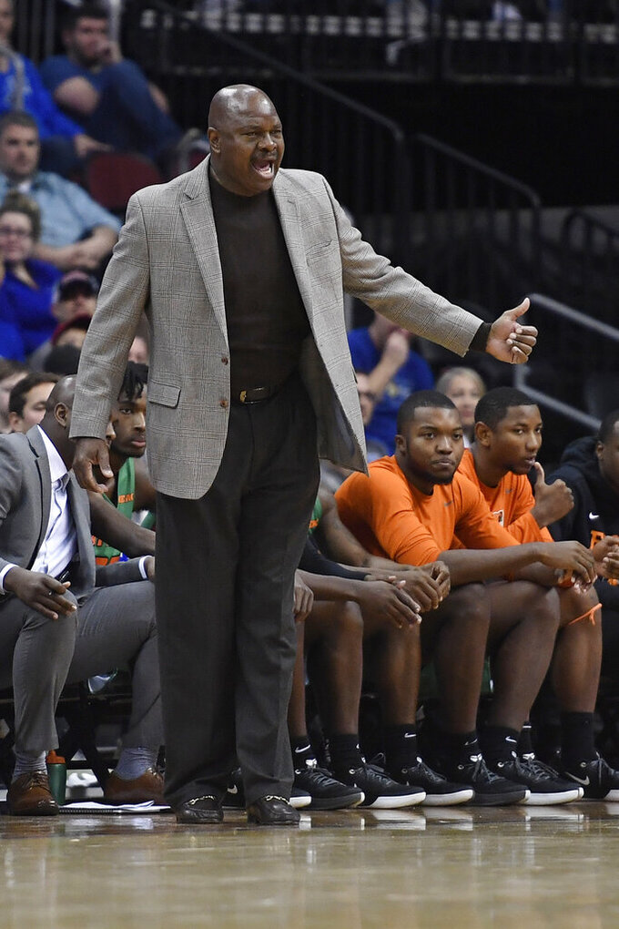 Florida A&M head coach Robert McCullum reacts during the first half of an NCAA college basketball game against Seton Hall, Saturday, Nov. 23, 2019 in Newark, N.J. (AP Photo/Sarah Stier)