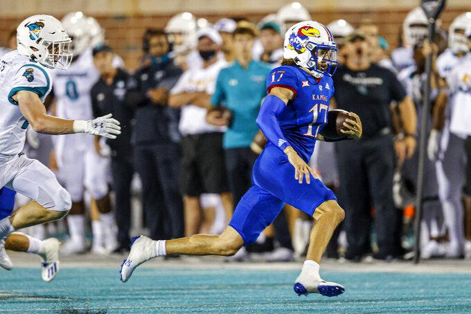 Kansas quarterback Jason Bean runs for a touchdown against Coastal Carolina during the second half of an NCAA college football game in Conway, S.C., Friday, Sept. 10, 2021. Coastal Carolina won 49-22. (AP Photo/Nell Redmond)