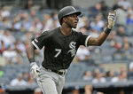 Chicago White Sox's Tim Anderson urges his ball over the wall after he hit a grand slam during the fourth inning of a baseball game against the New York Yankees at Yankee Stadium, Sunday, April 14, 2019, in New York. (AP Photo/Seth Wenig)