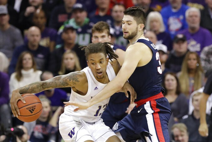 Washington's Hameir Wright (13) tries to keep the ball away from Gonzaga's Killian Tillie in the first half of an NCAA college basketball game Sunday, Dec. 8, 2019, in Seattle. (AP Photo/Elaine Thompson)