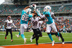 Miami Dolphins tight end Chris Myarick (85) makes a catch for a touchdown over Cincinnati Bengals defensive back Winston Rose (39) in the second half of an NFL exhibition football game in Cincinnati, Sunday, Aug. 29, 2021. (AP Photo/Bryan Woolston)