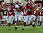 Alabama wide receiver John Metchie (3) catches a long pass ahead of Alabama defensive back Scooby Carter (11) and Alabama defensive back Joshua Robinson (25) during the first half of Alabama's A-Day NCAA college football scrimmage, Saturday, April 13, 2019, in Tuscaloosa, Ala. Alabama quarterback Mac Jones (10) was the quarterback on the throw. (AP Photo/Vasha Hunt)