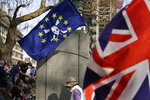 FILE - In this March 29, 2019, file photo, Pro-Brexit leave the European Union supporters wave flags in Parliament Square at the end of the final leg of the