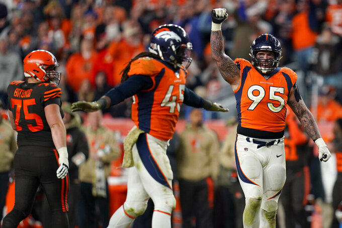 Denver Broncos defensive end Derek Wolfe (95) and linebacker A.J. Johnson (45) celebrate a defensive stop during the second half of an NFL football game against the Cleveland Browns, Sunday, Nov. 3, 2019, in Denver. The Broncos won 24-19. (AP Photo/Jack Dempsey)