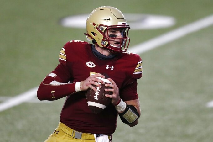 Boston College quarterback Phil Jurkovec drops back to pass during the first half of an NCAA college football game against Georgia Tech, Saturday, Oct. 24, 2020, in Boston. (AP Photo/Michael Dwyer)
