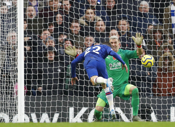 Chelsea's Christian Pulisic, left, scores his sides second goal past Crystal Palace's goalkeeper Vicente Guaita during their English Premier League soccer match between Chelsea and Crystal Palace at Stamford Bridge stadium in London, Saturday, Nov. 9, 2019. (AP Photo/Alastair Grant)