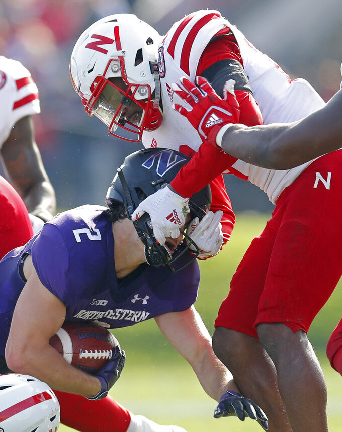 Northwestern's Flynn Nagel, left, is tackled by Nebraska's Aaron Williams during the second half of an NCAA college football game Saturday, Oct. 13, 2018, in Evanston, Ill. (AP Photo/Jim Young)