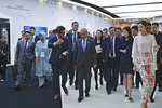 Malaysian Prime Minister Mahathir Mohamad, center, is accompanied by Huawei founder and CEO Ren Zhengfei, third from right, and officials as he visits to Huawei Executive Briefing Center in Beijing, Thursday, April 25, 2019. Mahathir is in Beijing to attend the Belt and Road Forum which start on this weekend. (AP Photo/Andy Wong)