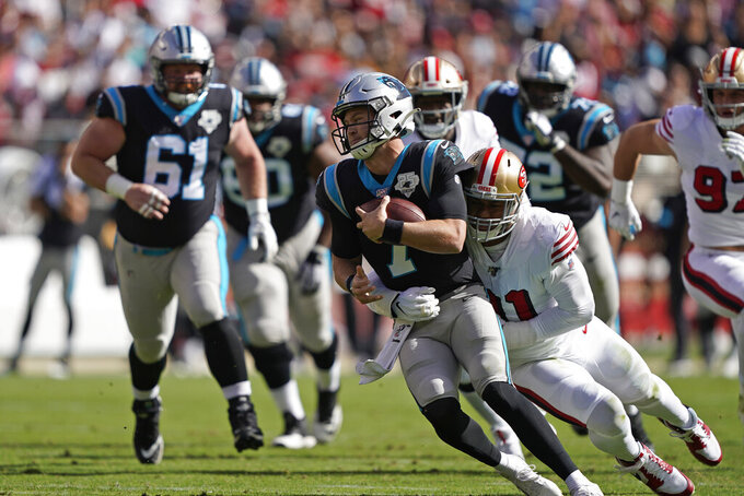 Carolina Panthers quarterback Kyle Allen is sacked by San Francisco 49ers defensive end Arik Armstead during the first half of an NFL football game in Santa Clara, Calif., Sunday, Oct. 27, 2019. At left is Carolina Panthers center Matt Paradis (61). (AP Photo/Tony Avelar)