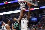 New Orleans Pelicans forward Zion Williamson (1) shoots against Boston Celtics center Daniel Theis (27) in the first half of an NBA basketball game in New Orleans, Sunday, Jan. 26, 2020. (AP Photo/Gerald Herbert)