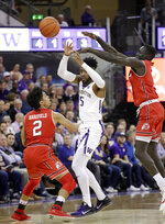 Washington's Jaylen Nowell (5) passes the ball while Utah's Sedrick Barefield (2) and Both Gach defend during the first half of an NCAA college basketball game Wednesday, Feb. 20, 2019, in Seattle. (AP Photo/Elaine Thompson)
