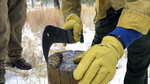 In this Thursday, Oct. 24, 2019, photo Nick Naranjo with Santa Clara Pueblo's forestry department chops a ponderosa pine cone in half during a demonstration at Bandelier National Monument near Los Alamos, N.M. A cone collecting effort is underway in parts of New Mexico and Colorado as conservationists and land managers work to gather seeds to restore forested landscapes following wildfire. (AP Photo/Susan Montoya Bryan)