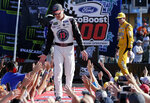 Kevin Harvick is introduced before a NASCAR Cup Series Championship auto race at the Homestead-Miami Speedway, Sunday, Nov. 18, 2018, in Homestead, Fla. (AP Photo/Terry Renna)