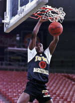 FILE - In this March 24, 1988, file photo, Iowa's Roy Marble dunks during practice at the West Regionals of the NCAA college basketball tournament in Seattle. Iowa athletic director Gary Barta apologized to the family of Hawkeyes basketball great Roy Marble on Tuesday, March 9, 2021 for any hard feelings they have over the retirement of star player Luka Garza's No. 55 jersey. (AP Photo/Gary Stewart, File)