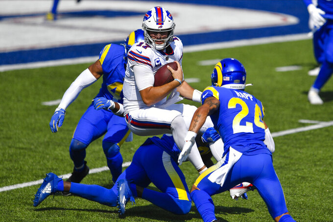 Buffalo Bills quarterback Josh Allen rushes during the first half of an NFL football game against the Los Angeles Rams Sunday, Aug. 26, 2018, in Orchard Park, N.Y. (AP Photo/Adrian Kraus)