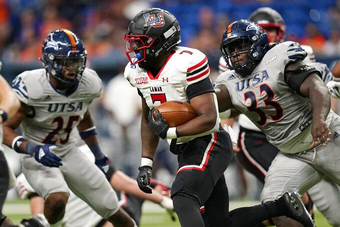 Lamar running back Chaz Ward (7) runs against UTSA during the second half of an NCAA college football game, Saturday, Sept. 11, 2021, in San Antonio. (AP Photo/Eric Gay)