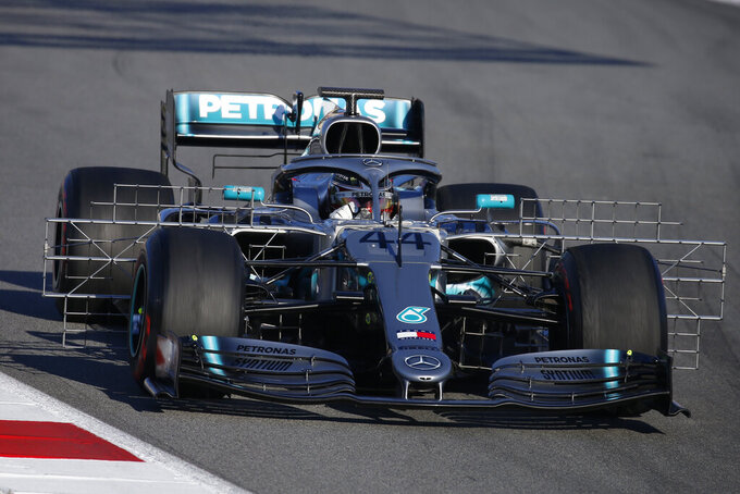FILE - In this file photo dated Tuesday, Feb. 26, 2019, Mercedes driver Lewis Hamilton of Britain steers his car during a Formula One pre-season testing session at the Catalunya racetrack in Montmelo, outside Barcelona, Spain.  Previewing the upcoming 2019 season, last season was arguably Hamilton's best to date but he is ready to launch his quest for the next Formula One world championship title.  (AP Photo/Joan Monfort, FILE)