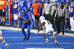 Boise State running back Andrew Van Buren (21) turns up field after a reception as Utah State cornerback Cam Lampkin (6) closes in during the second half in an NCAA college football game Saturday, Oct. 24, 2020, in Boise, Idaho. Boise State won 42-13. (AP Photo/Steve Conner)