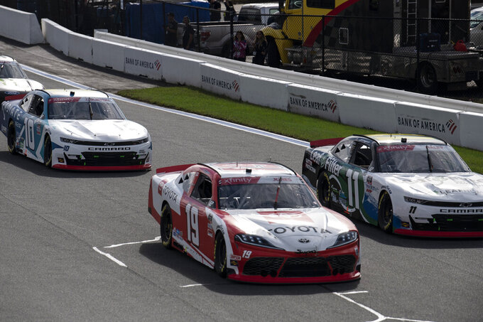 NASCAR Xfinity Series driver Brandon Jones (19) leads a pack of cars during the NASCAR Xfinity auto racing race at the Charlotte Motor Speedway Saturday, Oct. 9, 2021, in Concord, N.C. (AP Photo/Matt Kelley)