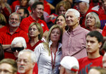 FILE - In this March 5, 2016, file photo, Kelly and Lute Olson stand during the second half of Arizona's NCAA college basketball game against Stanford in Tucson, Ariz. Lute Olson, the Hall of Fame coach who turned Arizona into a college basketball powerhouse, has died. He was 85. Olson's family said he died Thursday evening, Aug. 27, 2020. The family didn't provide the cause of death. (AP Photo/Rick Scuteri, File)