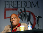"""FILE - In this June 26, 2014 file photo, Robert """"Bob"""" Moses, Student Nonviolent Coordinating Committee (SNCC) project director in 1964, discusses the importance of Freedom Summer 1964 during the 50th Anniversary conference at Tougaloo College in Jackson, Miss.  Moses, a civil rights activist who endured beatings and jail while leading Black voter registration drives in the American South during the 1960s and later helped improve minority education in math, died Sunday, July 25, 2021, in Hollywood, Fla. He was 86.  (AP Photo/Rogelio V. Solis)"""