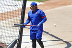 New York Mets left fielder Yoenis Cespedes emerges from the batting cage during the afternoon session of a summer baseball training camp workout at Citi Field, Thursday, July 9, 2020, in New York. (AP Photo/Kathy Willens)