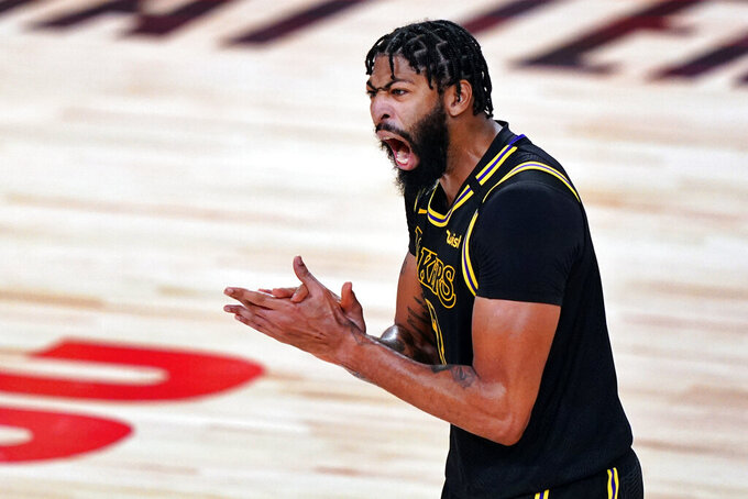 FILE - In this Oct. 9, 2020, file photo, Los Angeles Lakers forward Anthony Davis celebrates during the second half in Game 5 of basketball's NBA Finals against the Miami Heat in Lake Buena Vista, Fla. Davis is the biggest name on the free agency board; he turned down his option for this season with the Lakers but isn't expected to go anyplace else. (AP Photo/Mark J. Terrill, File)