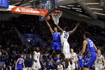 Creighton's Davion Mintz (1) goes up for a shot against Villanova's Dhamir Cosby-Roundtree (21) during the first half of an NCAA college basketball game Wednesday, Feb. 6, 2019, in Villanova, Pa. (AP Photo/Matt Slocum)