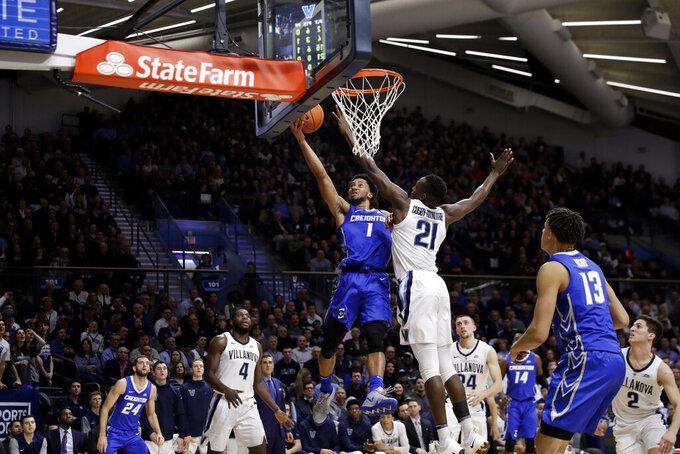 Creighton's Davion Mintz (1) goes up for a shot against Villanova's Dhamir Cosby-Roundtree (21) during the first half of an NCAA college basketball game Wednesday, Feb. 6, 2019, in Villanova, Pa. (AP Photo/Matt Slocum)