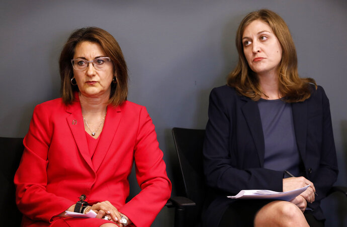 Planned Parenthood of the Heartland President and CEO Suzanna de Baca, left, and ACLU of Iowa Legal Director Rita Bettis look on during a news conference, Tuesday, May 15, 2018, in Des Moines, Iowa. Planned Parenthood and the American Civil Liberties Union said Tuesday that they had filed a lawsuit challenging the nation's most restrictive abortion law, an Iowa provision that bans most abortions once a fetal heartbeat is detected, around the sixth week of pregnancy. (AP Photo/Charlie Neibergall)