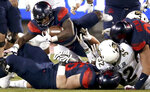 Arizona running back J.J. Taylor (21) throws himself over the pile at the line for an extra yard against Colorado during the first quarter of an NCAA college football game Friday, Nov. 2, 2018, in Tucson, Ariz. (Kelly Presnell/Arizona Daily Star via AP)